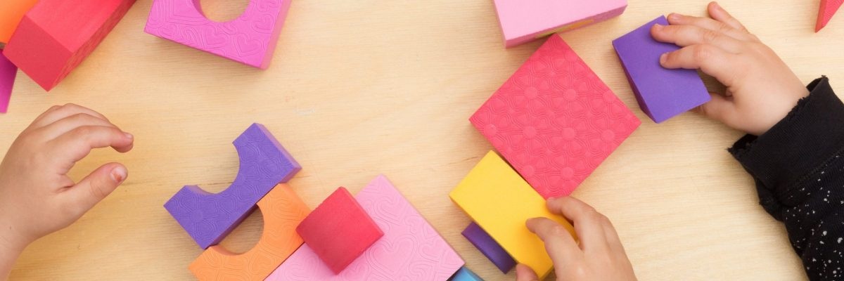 toddler-hands-playing-with-colorful-blocks-1
