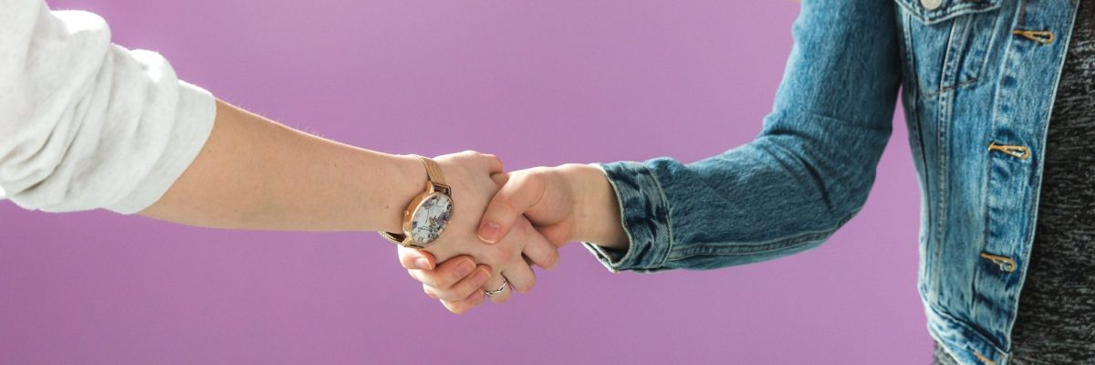 business-woman-shakes-hand-1